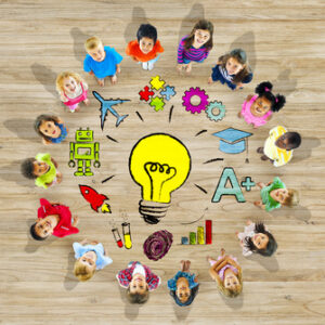 Group of Children in Circle with Light Bulb